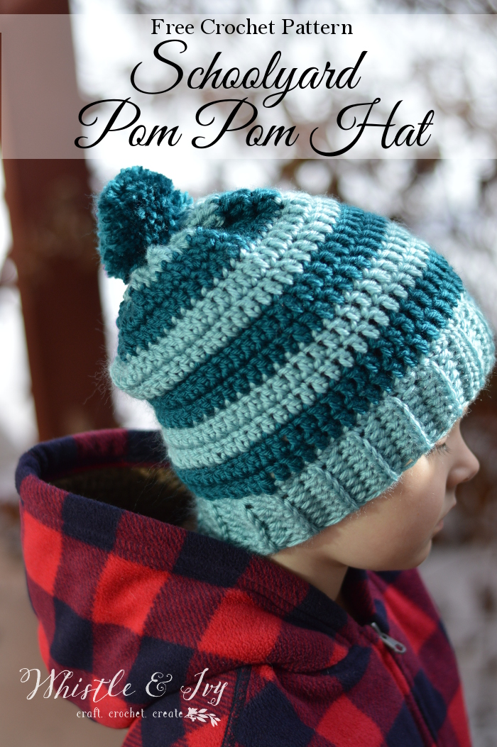 Free Crochet Pattern: Schoolyard Pom-Pom Hat | Bundle up your kids with this cute (and easy) striped pom pom hat, perfect for recess and walks to school.