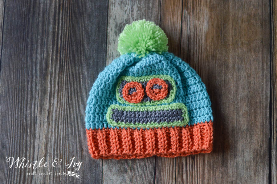 FREE Crochet Pattern: Kids Crochet Robot Hat | Beep! Beep! Boop! This adorable robot-themed hat is perfect for keeping your kids warm the winter.