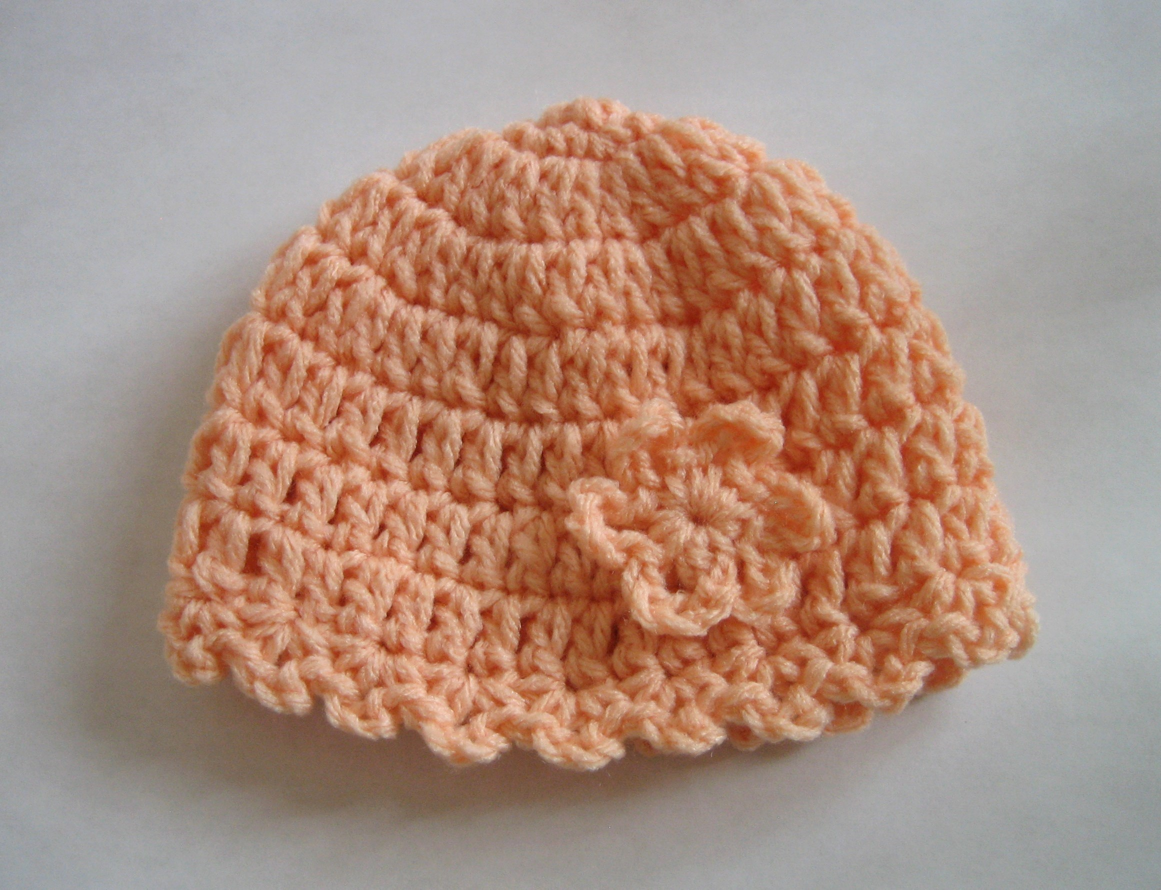 64378b095 Crochet Pattern of the Day: Little Flower Baby Hat - Stitch and Unwind