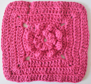 Circle of Bobbles Washcloth, free crochet pattern by Underground Crafter for Stitch and Unwind